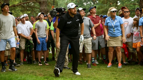Shane Lowry looks on after hitting a vital recovery shot on the 18th hole