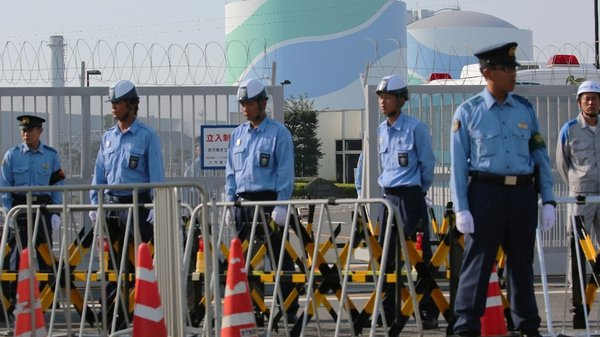 Police officers and security personnel at the Sendai nuclear power plant