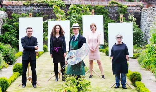 Painter Mick O'Dea pictured with subjects at the Kilkenny Arts Festival in 2016 - his Open Studio returns this year.