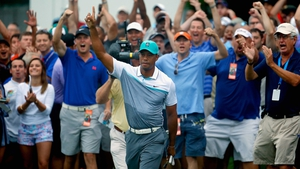 Fans in Greensboro react raucously to Tiger Woods' chip-in birdie on the 10th hole at Sedgefield Country Club
