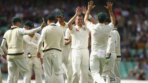 Peter Siddle of Australia celebrates after taking the wicket of Stuart Broad