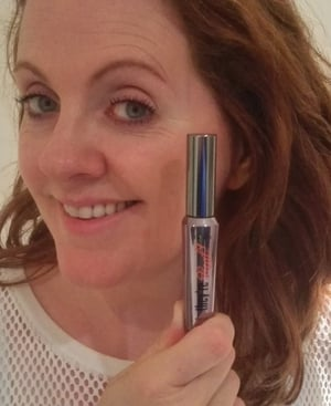 "Ruth Scott demonstrating Benefit's ""They're Real!"" mascara"