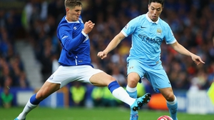 John Stones (L) is coveted by a number of Premier League clubs