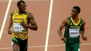 Usain Bolt had time for a chat as he crossed the line in his 200m semi-final