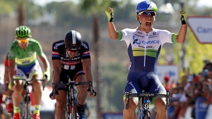 Caleb Ewan crosses the line to claim his first Grand Tour stage win