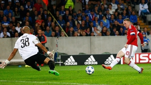 Wayne Rooney scored a hat-trick as Man Utd returned to the group stages of the Champions League