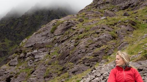 Deirdre taking a break while climbing Carrauntoohil