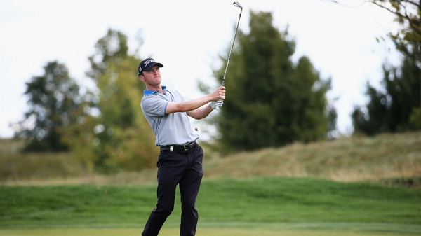 Michael Hoey watches his iron shot on the second hole at Albatross Golf Resort