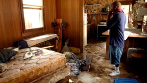Duane Bush, who stayed in his house until the water was chest high and eventually waded through water neck high to escape, looking over the inside of his house after making the first trip back since the water went down in New Orleans