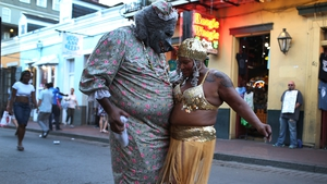 Ghetto Priest (L) and Marie Francois dance together in the French Quarter during commemoration events to mark 10 years since Hurricane Katrina
