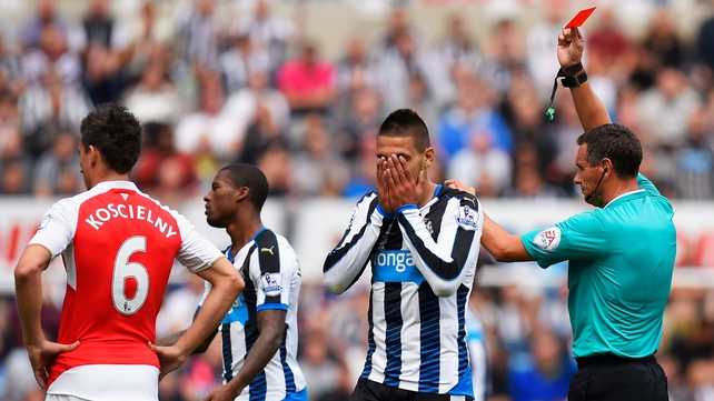 Arsenal labour to victory over 10-man Newcastle