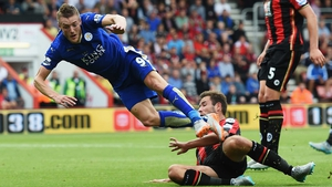 Steve Cook of Bournemouth takes down Jamie Vardy of Leicester City