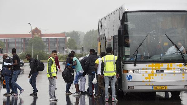 Asylum seekers arrive by bus at the Zeelandhallen in Goes in southwestern Netherlands