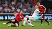 Bastian Schweinsteiger and Jonjo Shelvey contest a 50/50 ball