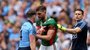 Philly McMahon grips the jersey of Aidan O'Shea during the drawn All-Ireland semi-final