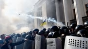 Protesters clash with police officers in front of parliament buldings in Kiev, Ukraine