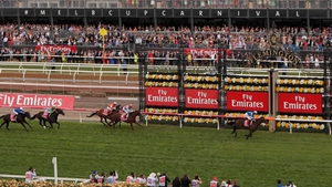 Red Cadeaux chases home Protectionist in last season's Melbourne Cup