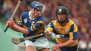 Niall Gilligan of Clare tackles Conal Bonnar of Tipperary
