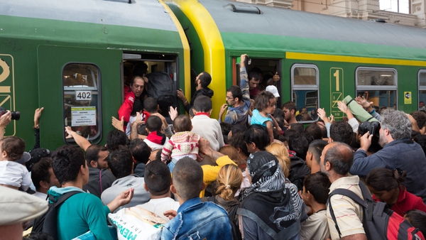Hundreds of people crammed onto trains at Budapest station