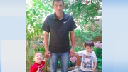 Aylan Al-Kurdi (L) and his brother Galip (R) with their father Abdukkah (C)
