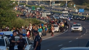 A group of around 500 refugees and migrants have been marching on a Hungarian motorway towards the Austrian border