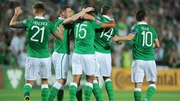 Cyrus Chrstie is congratulated by his Ireland team-mates after scoring his first international goal against Gibraltar