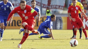 Wayne Rooney slots home his 49th international goal from the penalty spot