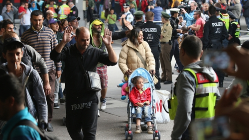 The first of thousands of Syrian refugees expected, arrived in Munich aboard special trains