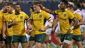 Australia's Sean McMahon is congratulated after scoring a try at Soldier Field