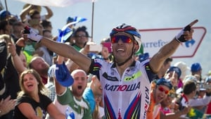 Joaquim Rodriguez celebrates victory at the summit of today's 15th stage