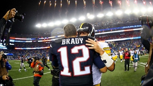 Tom Brady and opposition quarterback Ben Roethlisberger embrace after the season opener
