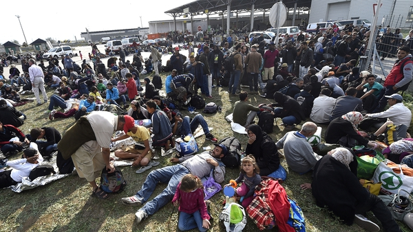 Refugees arrive from Hungary after crossing the border in Nickelsdorf, Austria
