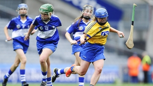 Roscommon's Aisling Byrne with Aisling O'Dea of Laois who loses her hurl in the All-Ireland junior camogie final