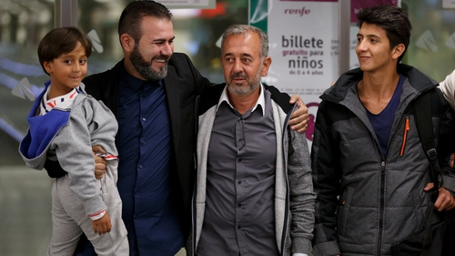 Osama Abdul Mohsen (2R), is pictured with his sons Mohamed, 18, and seven-year-old Zaid along with Miguel Angel Galan on their arrival in Madrid