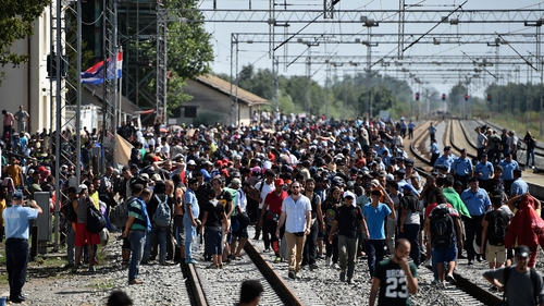 People wait at Tovarnik station in Croatia for a train to Zagreb