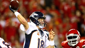 Peyton Manning of the Denver Broncos throws a pass during the game against the Kansas City Chiefs