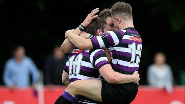 Terenure's James O'Donoghue celebrates his try with Stephen O'Neill and Harrison Brewer