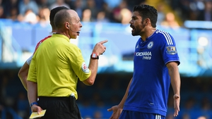 Diego Costa remonstrates with referee Mike Dean