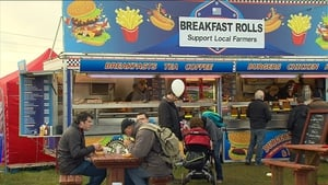 People enjoy breakfast at one of the many food stands