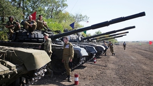 Pro-Russian separatists take part in a military competition between tank units near the town of Torez, near Donetsk