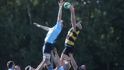 UCD's Emmet MacMahon competes with Michael Madden of Young Munster