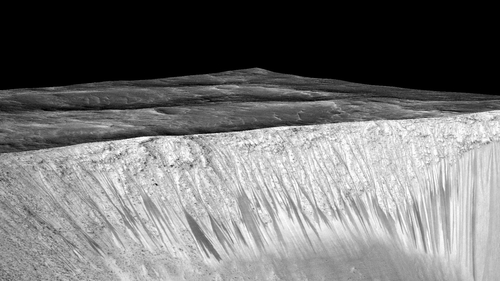 US researchers said long gullies running down slopes on Mars were caused by flowing water