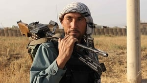 An Afghan policeman holds a gun on his shoulder a day after Taliban insurgents overran the strategic northern city of Kunduz