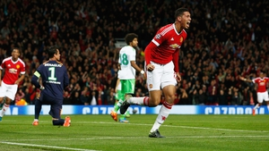 Chris Smalling celebrates his goal,  which turned out to be the winner