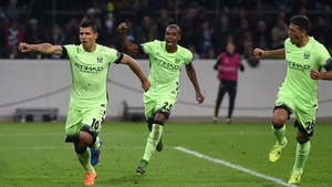 Sergio Aguero (l) scored a late winner for Manchester City