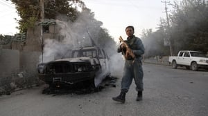 Afghan security forces make their way to the centre of Kunduz to regain control of the city