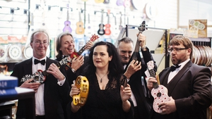Members of the RTÉ Concert Orchestra try out some new instruments for size