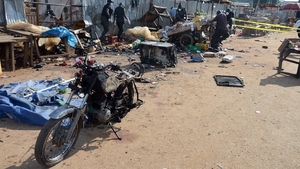 One of the bombs went off near a police station in the satellite town of Kuje