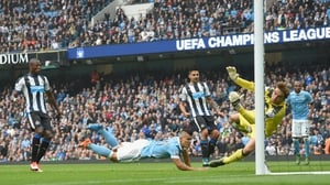 Sergio Aguero scores the opening goal for Manchester City
