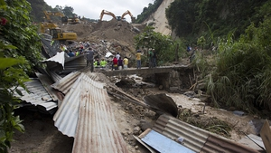 Families scrabbled through rubble to find the bodies of loved-ones